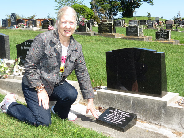 Geraldene O'Reilly at the grave of Paddy Sullivan at the Otaki Cemetery