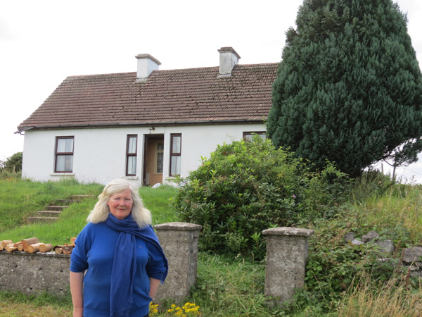 The author's cousin Fidelma Burke on the site where the Burke family grew up in the townland of Ballydotia, Moycullen Co Galway