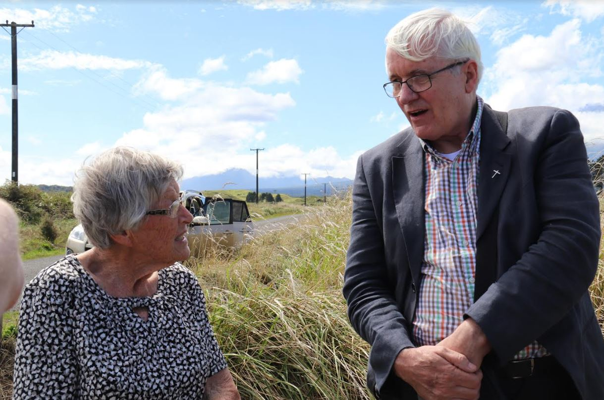 Fr Eamon talks to Josie Hogan on the farm where Maurice lived
