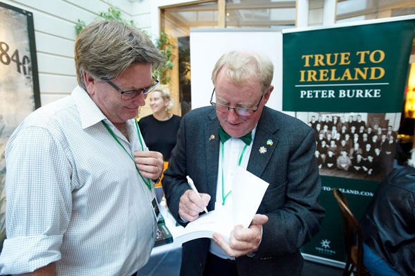 Peter Burke signing the book